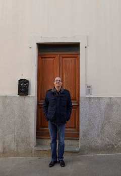 Rob in front of the old house's door